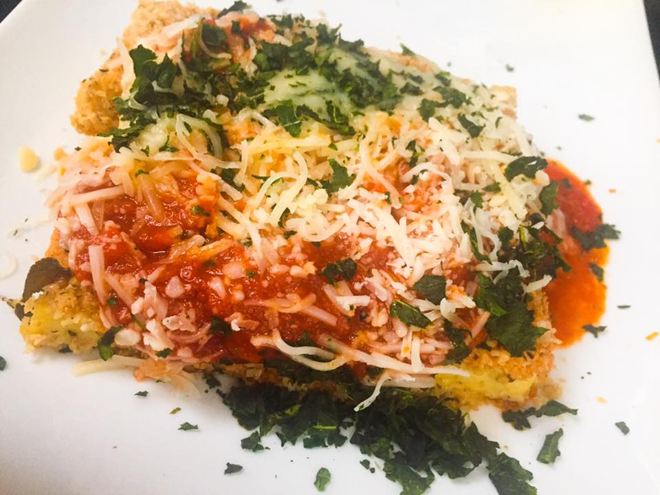 Tofu parmigiana - grated parmesan cheese and red marinara sauce on top of tofu