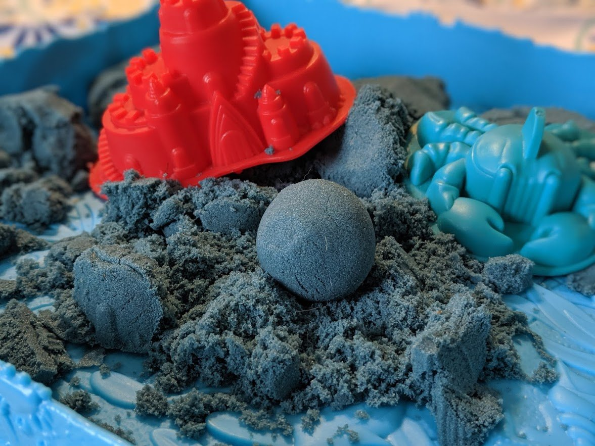 ball of blue kinetic sand