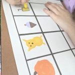 kid making stickers at home