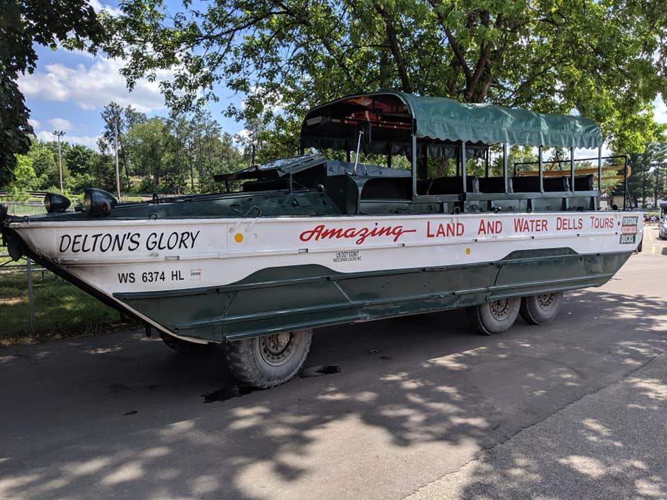 Green and white amphibious truck Wisconsin Ducks